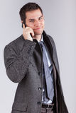 Young caucasian business man using a mobile phone. Portrait of a young caucasian business man using a mobile phone,isolated on white background Stock Photos