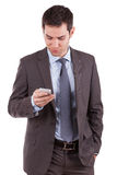 Young caucasian business man using a mobile phone. Portrait of a young caucasian business man using a mobile phone,isolated on white background Royalty Free Stock Photos