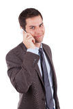 Young caucasian business man using a mobile phone. Portrait of a young caucasian business man using a mobile phone,isolated on white background Stock Photography