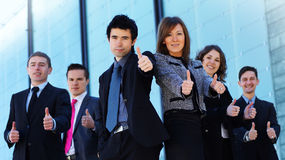 A young Caucasian business team in formal clothes Royalty Free Stock Photos