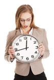 Young caucasian business woman holding clock. Stock Photos