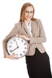 Young caucasian business woman holding clock. Royalty Free Stock Images