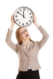 Young caucasian business woman holding clock. Royalty Free Stock Photography
