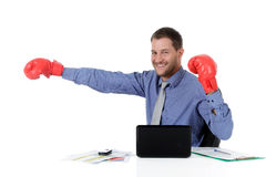 Young caucasian businessman, boxing gloves Royalty Free Stock Photos