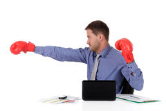 Young caucasian businessman, boxing gloves Stock Photo