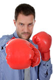 Young caucasian businessman, boxing gloves Royalty Free Stock Photography