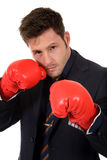 Young caucasian businessman, boxing gloves Stock Images