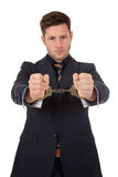 Young caucasian businessman in handcuffs. Studio shot. White background Royalty Free Stock Images