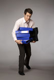 Young caucasian businessman holding a stack of binders Stock Photography