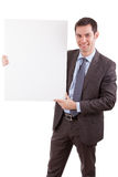 Young caucasian businessman holding a white board. Isolated on whitebackground Stock Photography