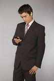 Young caucasian businessman playing with phone Royalty Free Stock Photo