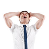 Young caucasian businessman screaming and pulling Stock Image