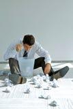 young caucasian businessman seeking document in trash bin Stock Photography