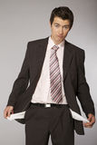 Young caucasian businessman showing his empty pockets Royalty Free Stock Photography