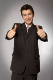 Young caucasian businessman showing ok gesture Royalty Free Stock Images
