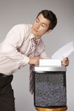 Young caucasian businessman shredding documents Royalty Free Stock Photography