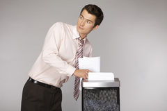 Young caucasian businessman shredding documents Royalty Free Stock Images
