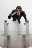 young caucasian businessman standing at the security gate Royalty Free Stock Photo