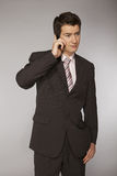 Young caucasian businessman talking on phone Royalty Free Stock Image