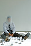 Young caucasian businessman with trash bin on his head Royalty Free Stock Photos