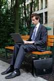 young caucasian businessman using his laptop in park Royalty Free Stock Photo