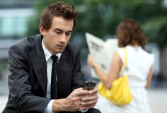 Young caucasian businessman using his phone Stock Images