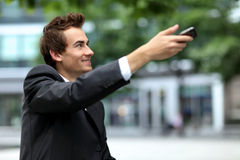 Young caucasian businessman using his phone Royalty Free Stock Image
