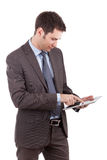 Young caucasian businessman using a tablet pc Royalty Free Stock Photography