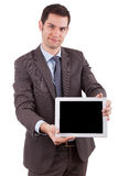 Young caucasian businessman using a tablet pc Stock Photos