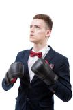 young caucasian businessman wearing boxing gloves. Royalty Free Stock Images