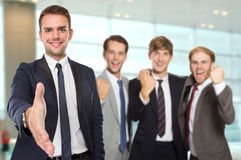 Young caucasian businessmen with success gesture Stock Photos