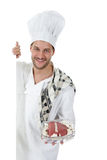 Young caucasian chef male, roast beef Royalty Free Stock Photos