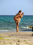 Young caucasian couple at the beach Stock Photos
