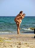 Young caucasian couple at the beach Stock Photos