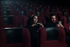 Young caucasian couple in cinema session. Stock Photo