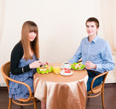 Young caucasian couple dining in restaurant. And smiling Royalty Free Stock Images