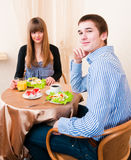 Young caucasian couple dining in restaurant Stock Photos