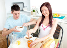 Young caucasian couple having breakfast together Royalty Free Stock Images