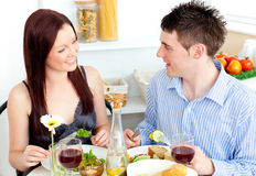 Young caucasian couple having dinner at home Royalty Free Stock Image