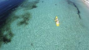 Young caucasian couple kayaking in sea at Maldives. Summer time holiday in Kuredu, Maledives. Canoe fun Stock Photography