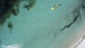 Young caucasian couple kayaking in sea at Maldives. Summer time holiday in Kuredu, Maledives. Canoe fun Stock Photo