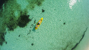 Young caucasian couple kayaking in sea at Maldives Royalty Free Stock Photography