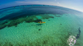 Young caucasian couple kayaking in sea at Maldives Stock Photo