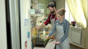 Young caucasian couple in kitchen. stock footage