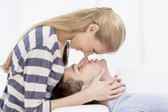 Young caucasian couple in livingroom Royalty Free Stock Photo