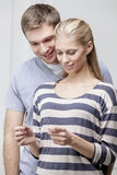 Young caucasian couple looking at Pregnancy Test Stock Images