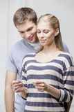 Young caucasian couple looking at Pregnancy Test Stock Image