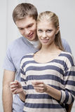 Young caucasian couple looking at Pregnancy Test Royalty Free Stock Photos