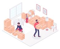 Young caucasian couple moving to a new house. Caucasian white couple moving to a new house and packing boxes. Young woman and man packing stuff in cardboard Royalty Free Stock Image