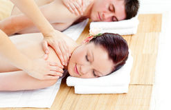 Young caucasian couple receiving a back massage stock photos